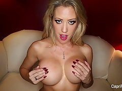 Seductive blonde, Capri Cavanni is toying her shaved pussy, while her boyfriend is watching her
